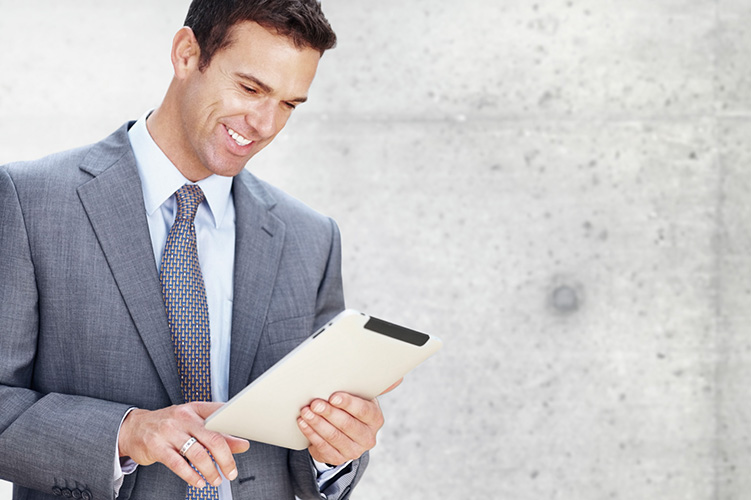 Businessman looking at document with team in the background